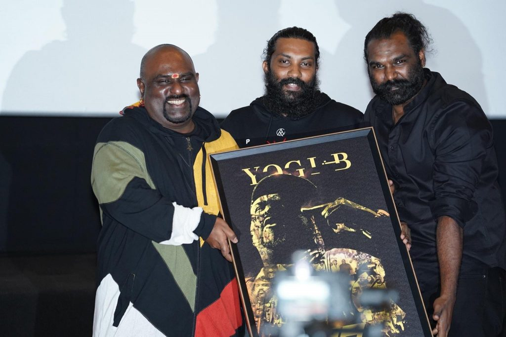 Yogi B receiving token of appreciation from JK Wicky & Ganesan